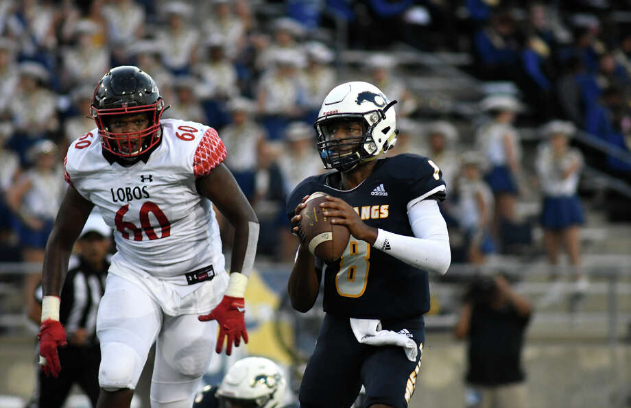 Cy Ranch junior quarterback DJ Ciers (8) escapes the pass rush of Langham Creek senior defensive lineman Ernest Thomas (60) in the first quarter of their matchup at CFFCU Stadium in Cypress on Sept. 12, 2019. Photo: Jerry Baker, Contributor / Houston Chronicle
