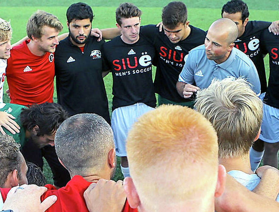 First-year SIUE coach Cale Wassermann gives his team pre-game instructions prior to last Friday's victory over Evansville at Korte Stadium. Photo: SIUE Athletics
