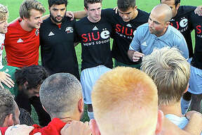 First-year SIUE coach Cale Wassermann gives his team pre-game instructions prior to last Friday's victory over Evansville at Korte Stadium.