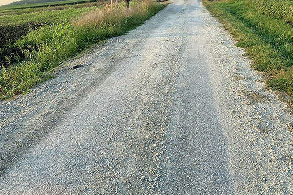 The Greene County Board says it wants Spire Energy to repair a 5-mile stretch of County Road 1000 East.