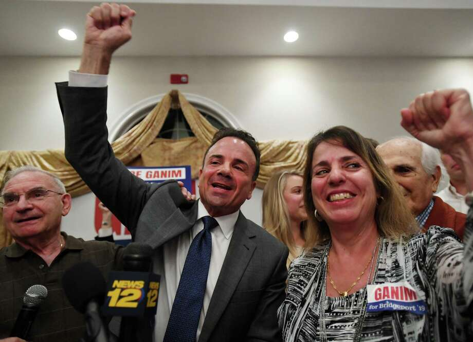 Bridgeport Mayor Joe Ganim celebrates his victory in the Bridgeport Democratic mayoral primary with his sister Roseanne Ganim, right, at Testo's Restaurant in Bridgeport, Conn. on Tuesday, September 10, 2019. At left is Democratic Town Committee Chairman Mario Testa. Photo: Brian Pounds / Hearst Connecticut Media / Connecticut Post