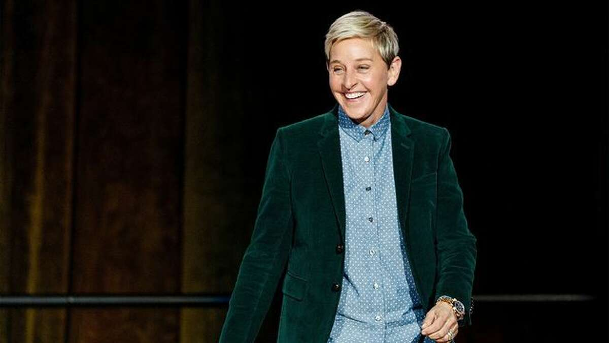 FILE -Sitting side-by-side in black padded seats with prime views of AT&T Stadium on Sunday were former Republican president George W. Bush and liberal television host Ellen DeGeneres, an outspoken LGBT activist.