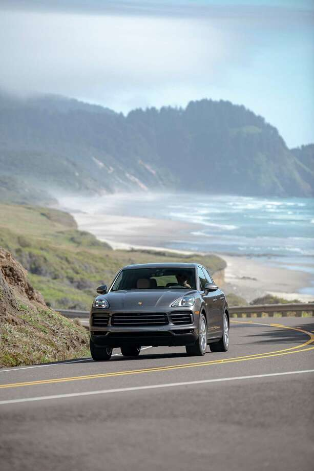 The 2019 Cayenne E-Hybrid runs staggered tire and wheel sizes for sportier handling.