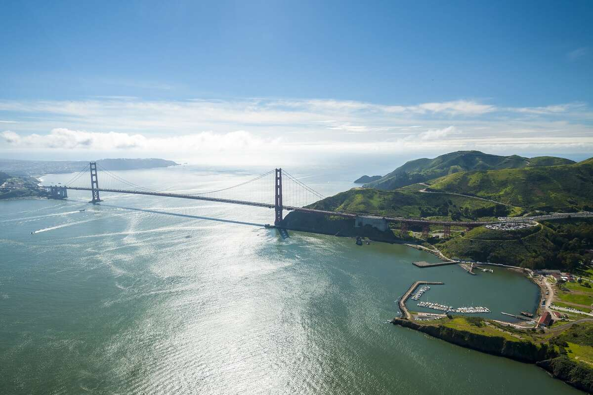 The iconic Golden Gate Bridge as seen from onboard a seaplane, with the Marin Headlands on the right.