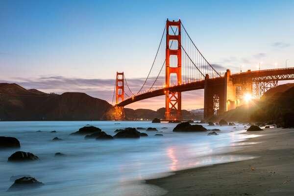 Dawn at the Golden gate bridge from Baker beach, San Francisco, California, USA