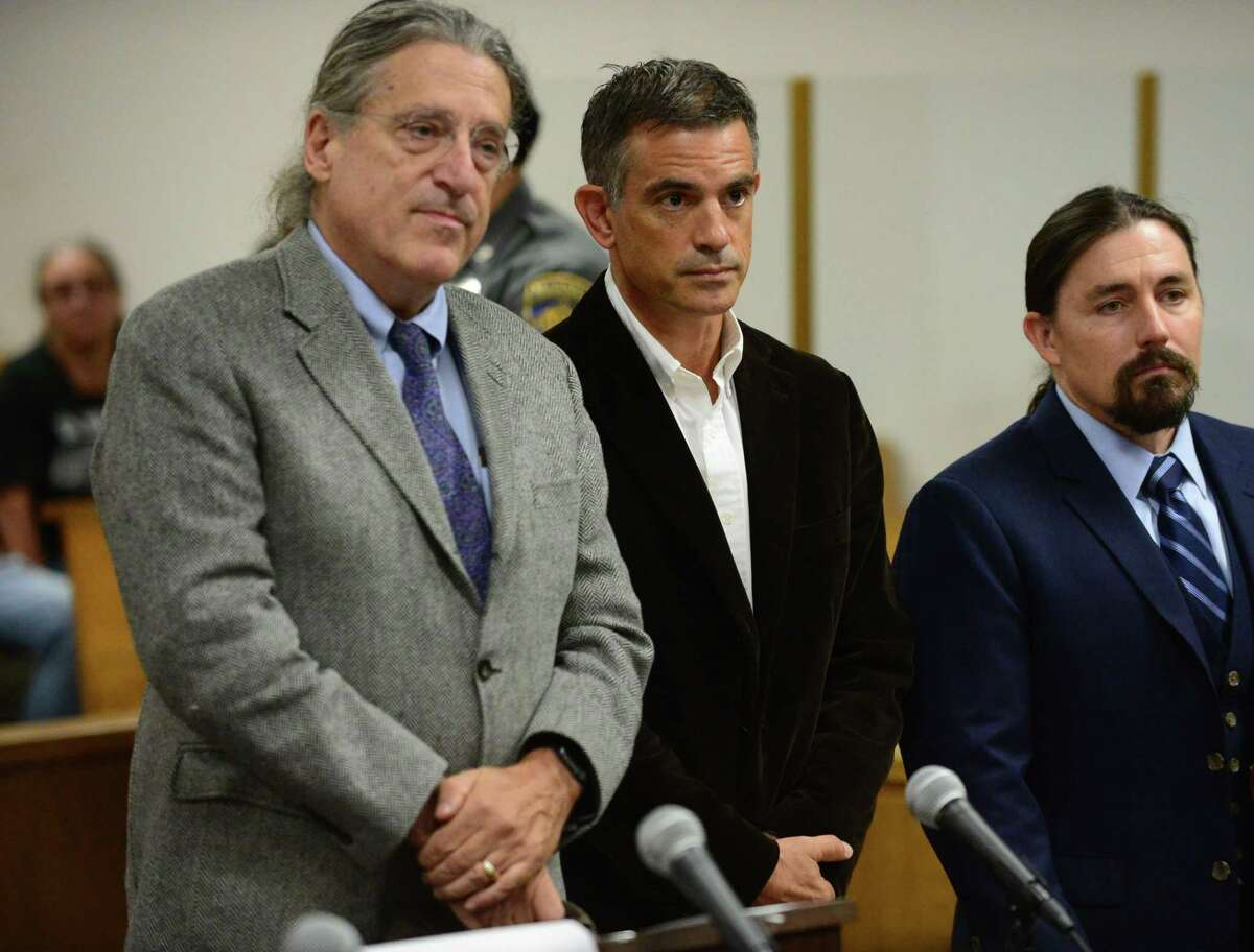 Fotis Dulos, center, appears with his attorney Norm Pattis, left, for arraignment on a new tampering with evidence charge Thursday, September 12, 2019, at state Superior Court in Norwalk, Conn.