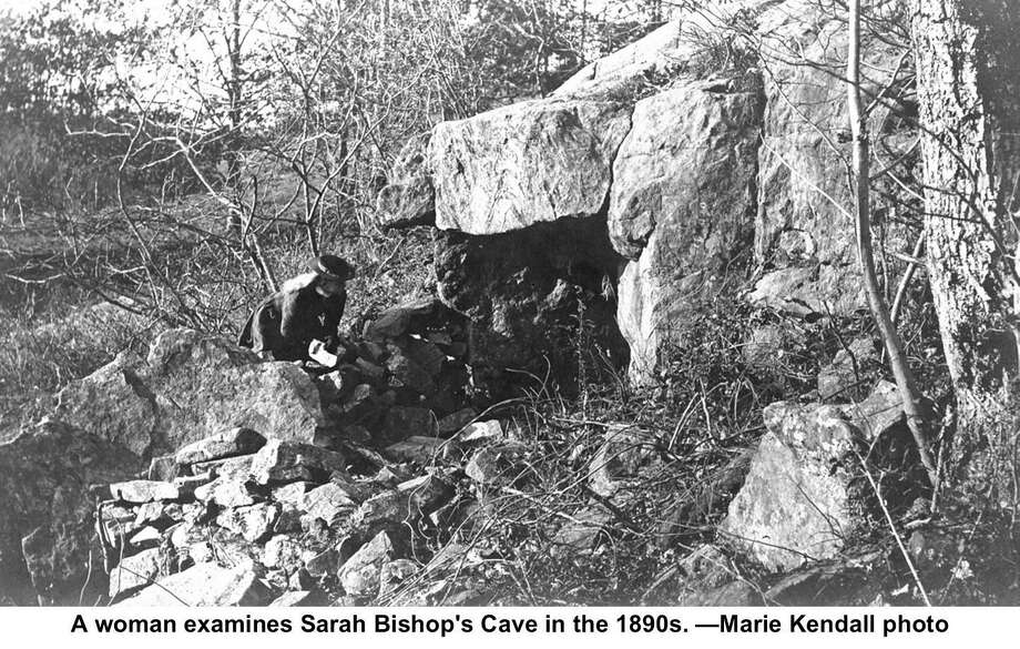 A woman examines Sarah Bishop's Cave in the 1890s. Photo: Marie Kendall Photo.