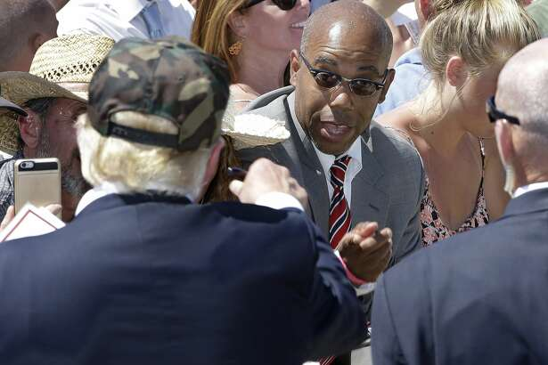"In this photo taken Friday, June 3, 2016, Republican presidential candidate Donald Trump, left, talks to Gregory Cheadle as he leaves a campaign rally at the Redding Municipal Airport, in Redding, Calif. Cheadle, whom Trump singled out while calling him ""my African-American,"" said Monday that he is now the target of harsh criticism, including comments he feels are more racist than the remark by the presumptive Republican presidential nominee. Cheadle also said Monday that he was not there to back Trump and that he is considering other possibilities as well, including Democratic candidate Sen. Bernie Sanders. (AP Photo/Rich Pedroncelli)"