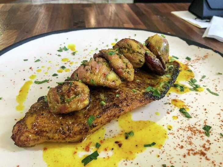 Blackened catfish with alligator sausage at Cherry Block in Bravery Chef Hall