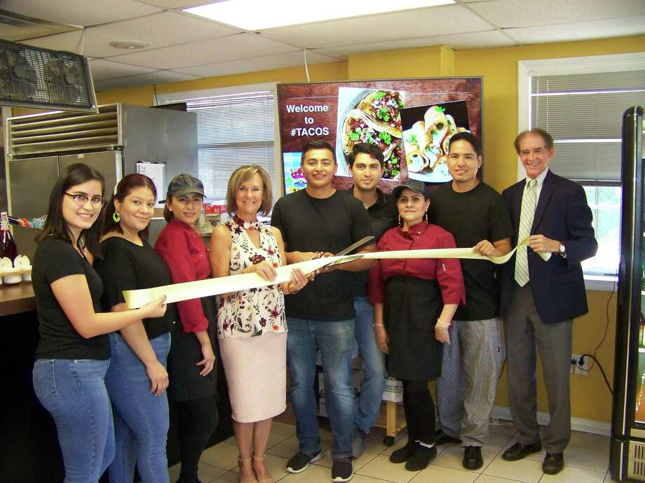 Taco time: From left, Thalia Campoverde; Denisse Brizuela; Brenda Caretto; Quinnipiac Chamber of Commerce Executive Director Dee Prior-Nesti; owner Jose Lara; owner Jorge Lamas; Leticia Cubillas; owner Alan Velasco; and Wallingford Mayor William Dickinson celebrate the grand opening of #Tacos, 360 Main St. The restaurant features fresh, authentic Mexican cuisine for eat-in or takeout. For information, call 203-444-7707. Photo: Contributed Photo