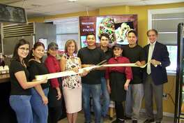Taco time: From left, Thalia Campoverde; Denisse Brizuela; Brenda Caretto; Quinnipiac Chamber of Commerce Executive Director Dee Prior-Nesti; owner Jose Lara; owner Jorge Lamas; Leticia Cubillas; owner Alan Velasco; and Wallingford Mayor William Dickinson celebrate the grand opening of #Tacos, 360 Main St. The restaurant features fresh, authentic Mexican cuisine for eat-in or takeout. For information, call 203-444-7707.