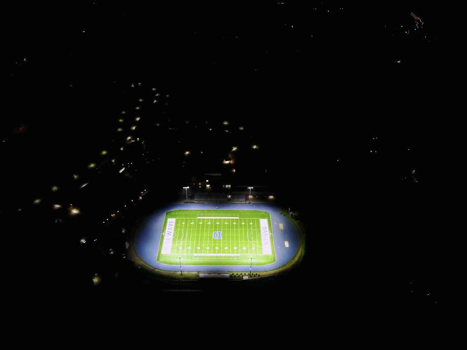 """An aerial view of the new """"Friday Night Lights"""" illuminating the Darien High School football field in Darien, Conn. Photo: Mark Maybell / Contributed Photo / Darien News"""