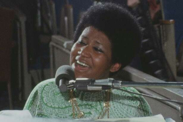 "Aretha Franklin, as seen in the documentary ""Amazing Grace,"" shot in 1972 during a live recording session for her double-platinum gospel album of the same name.."