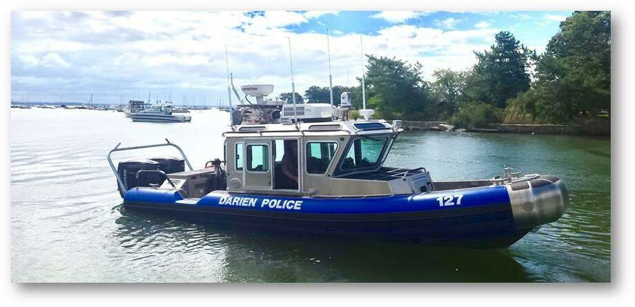 Darien Police rescued a capsized kayaker from the rough waters off Long Neck Point Friday morning. Photo: Darien Police Department / Darien News