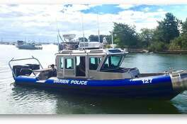 Darien Police rescued a capsized kayaker from the rough waters off Long Neck Point Friday morning.