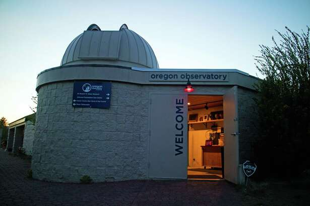 Red lights, which help eyes remain adjusted to darkness, greet visitors to the Oregon Observatory at Sunriver. The surrounding community's lighting ordinance protects the night sky from light pollution.