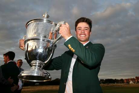 HOYLAKE, ENGLAND - SEPTEMBER 08: Cole Hammer of the United States poses with The Walker Cup as he celebrates his team's victory following the singles matches during Day 2 of the Walker Cup at Royal Liverpool Golf Club on September 08, 2019 in Hoylake, England. (Photo by Jan Kruger/R&A/R&A via Getty Images)