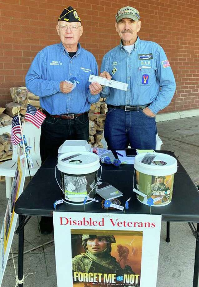 Jerry Augustine, right, commander of the Middletown Disabled Veterans, shows off the proceeds from the organization's recent Forget-Me-Not Drive. Photo: Contributed Photo