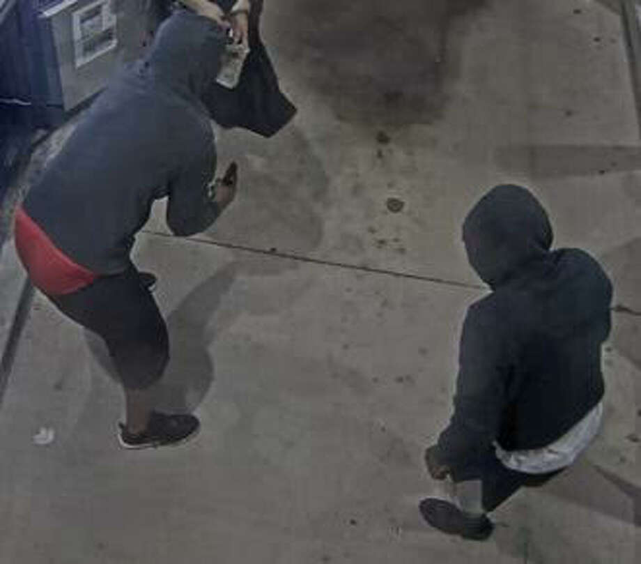 This photo from a surveillance video shows two suspects accused of robbing couriers from armored cars last month in Pearland and Kingwood. The FBI is offering a $15,000 reward for information leading to identification and arrest of the men. Photo: FBI