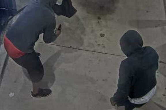 This photo from a surveillance video shows two suspects accused of robbing couriers from armored cars last month in  Pearland  and  Kingwood . The FBI is offering a $15,000 reward for information leading to identification and arrest of the men.