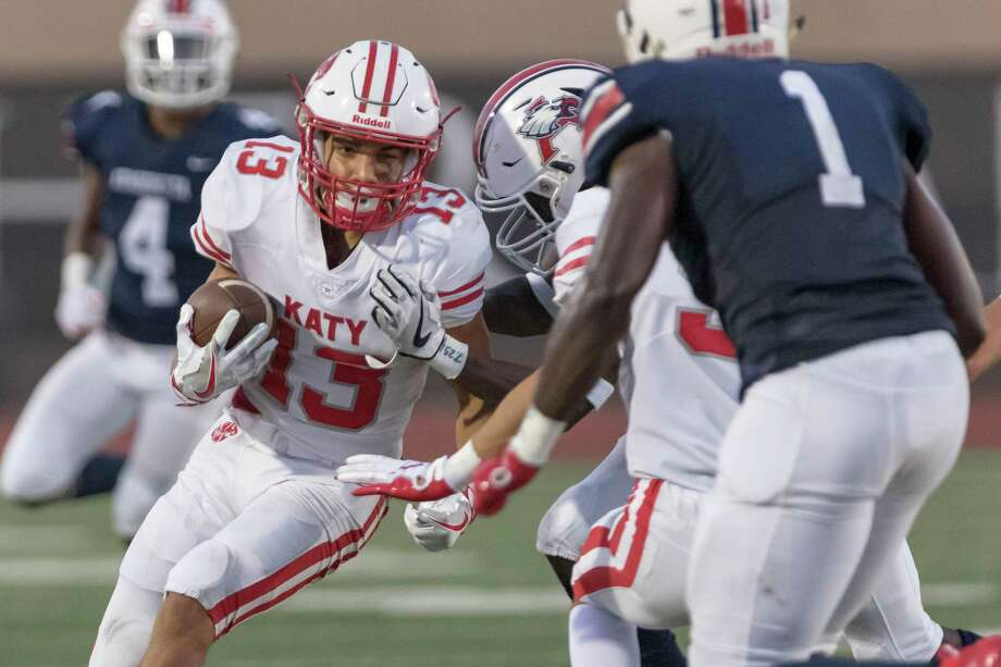 Katy receiver Jordan Patrick (13) catches a pass along the sideline for s first down before being shoved out-of-bounds during the first half of a high school football game Friday, Sep 6, 2019, in Humble, Texas. Photo: Joe Buvid, Houston Chronicle / Contributor / © 2019 Joe Buvid