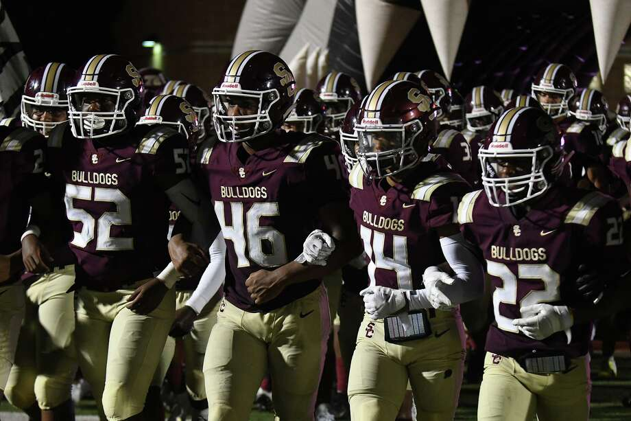 Summer Creek's Caden Wilson (52, Anthony Hall (46), Abel Medina (14), and Torrie Curry (22) lead the Bulldogs on the field before the 2nd half of their matchup with Pasadena Memorial at Turner Stadium in Humble on Sept. 12, 2019. Photo: Jerry Baker, Houston Chronicle / Contributor / Houston Chronicle