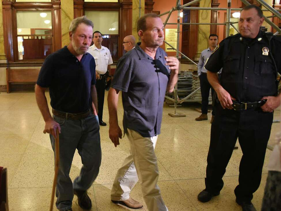 Robert King, left, enters the the courtroom as state Supreme Court Justice Patrick McGrath holds a red flag hearing on Matthew Reilly vs Robert King at Rensselaer County Courthouse on Friday, Sept. 13, 2019 in Troy, N.Y. (Lori Van Buren/Times Union)