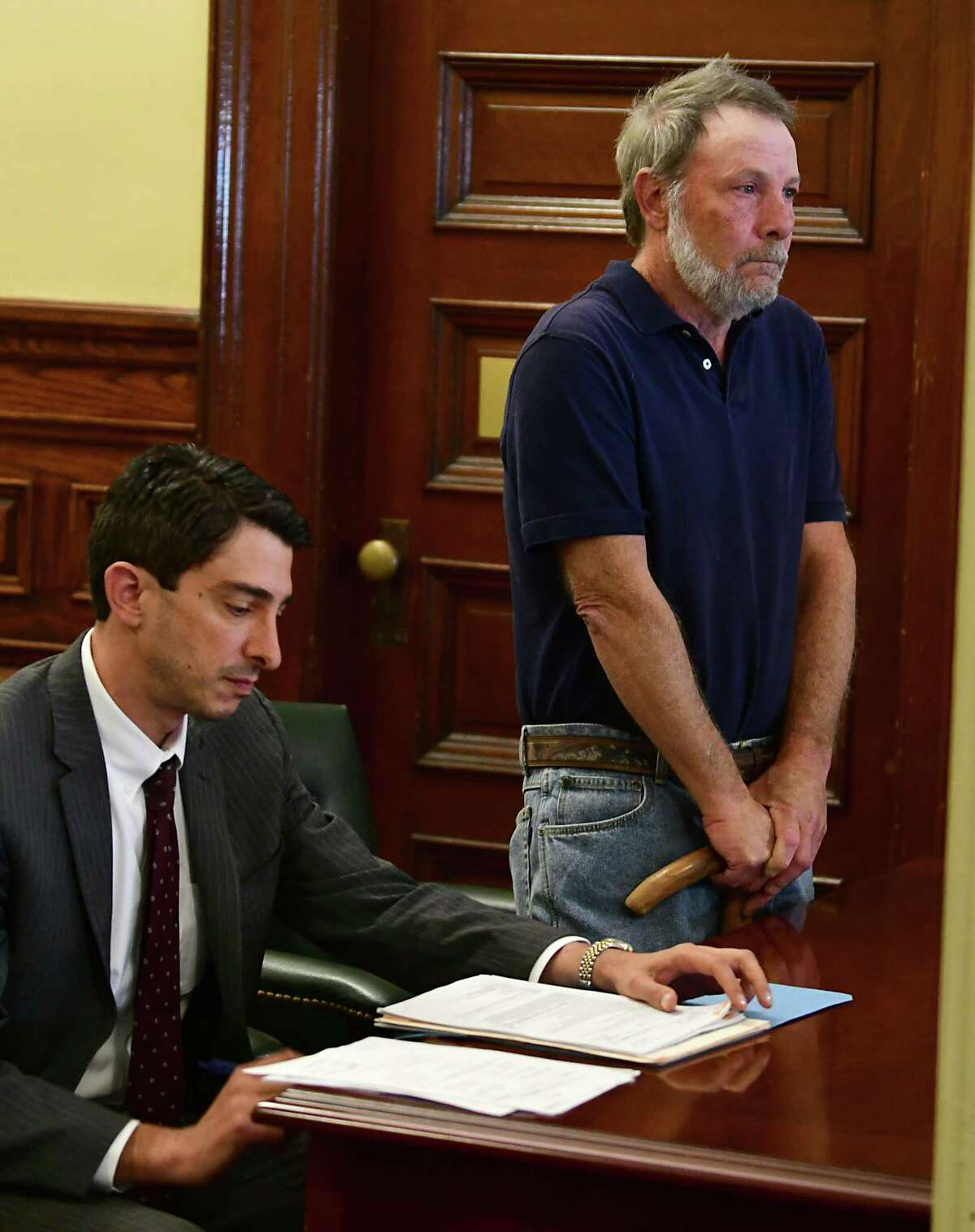 Robert King, right, stands before the judge next to his attorney Justin deArmas as state Supreme Court Justice Patrick McGrath holds a hearing to determine if King of Stephentown posses a risk to himself after or others after allegedly firing a weapon and threatening suicide during a Sept. 4 confrontation with a neighbor. (Lori Van Buren/Times Union)