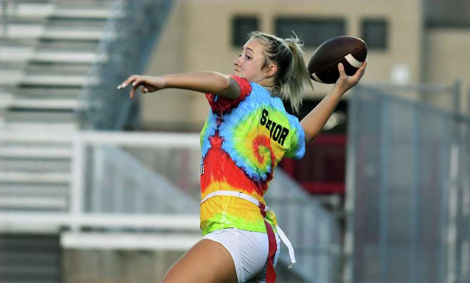 Crosby High School senior quarterback Tori Spencer drops back to pass against the spohomore defense during their CHS Powder Puff matchup at Cougar Stadium on Sept. 11, 2019. Photo: Jerry Baker, Houston Chronicle / Contributor / Houston Chronicle