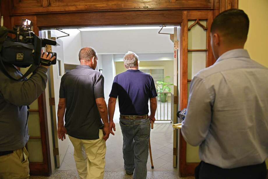 Robert King, second from right, is seen leaving the courtroom after State Supreme Court Justice Patrick McGrath ruled that het relinquished his guns at a red flag hearing on Matthew Reilly vs Robert King at Rensselaer County Courthouse on Friday, Sept. 13, 2019 in Troy, N.Y.  (Lori Van Buren/Times Union) Photo: Lori Van Buren, Albany Times Union / 20047800A