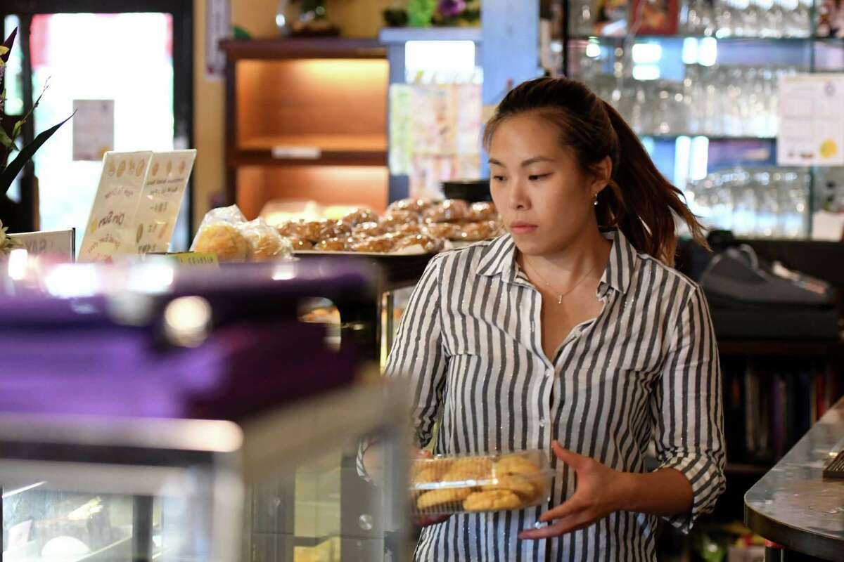 Vivian Chan, a native of Hong Kong who moved to the United States in the early 2000s, runs the Hong Kong Bistro & Bakery on Friday, Sept.13, 2019, on Wolf Road in Colonie, N.Y. Chan, who still has family in Hong Kong, is watching the civil unrest unfold from afar. (Will Waldron/Times Union)