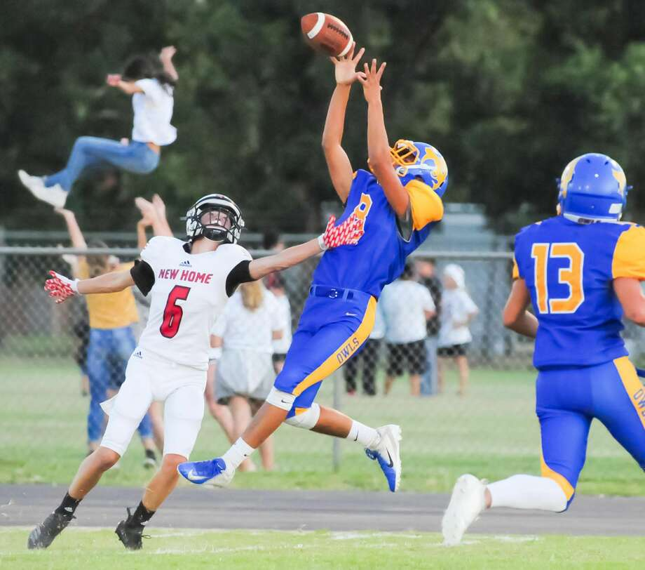 Hale Center senior receiver Michael Negrete catches a deep pass along the sidelines during the second quarter of the Owl's season opener against New Home on Aug. 30. Photo: Albert Gomez/For The Herald / Albert Gomez Photography