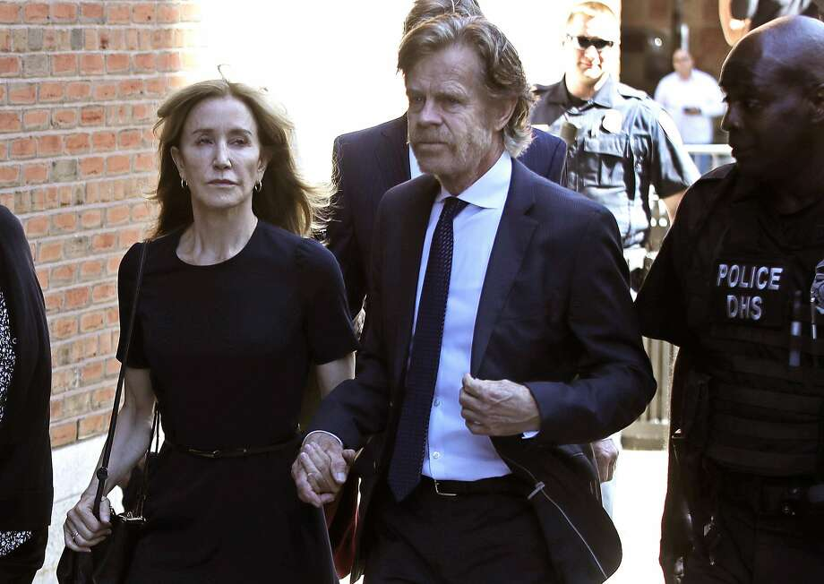 Actress Felicity Huffman arrives at federal court in Boston with her husband, actor William H. Macy, for sentencing in a nationwide college admissions bribery scandal. Photo: Elise Amendola / Associated Press