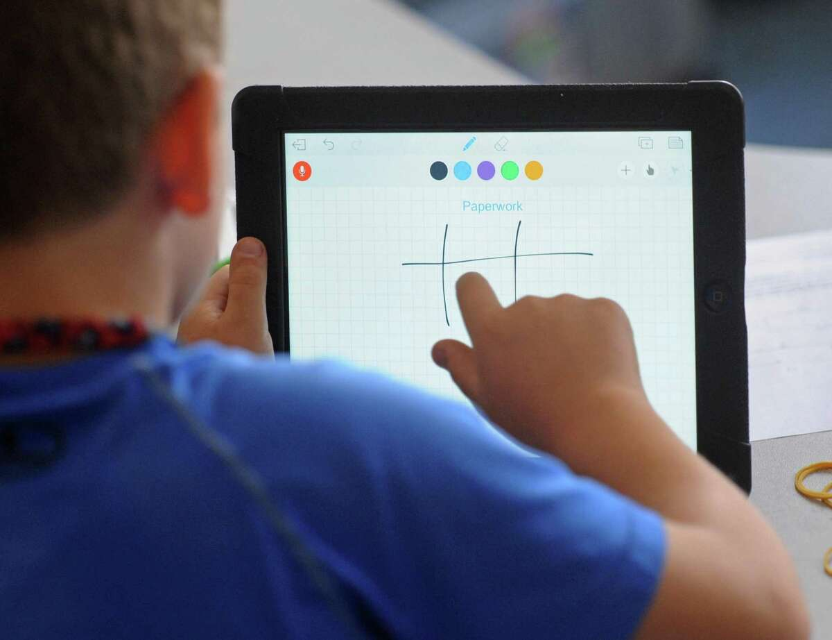 A fourth-grader works on an iPad at North Mianus School in Greenwich.
