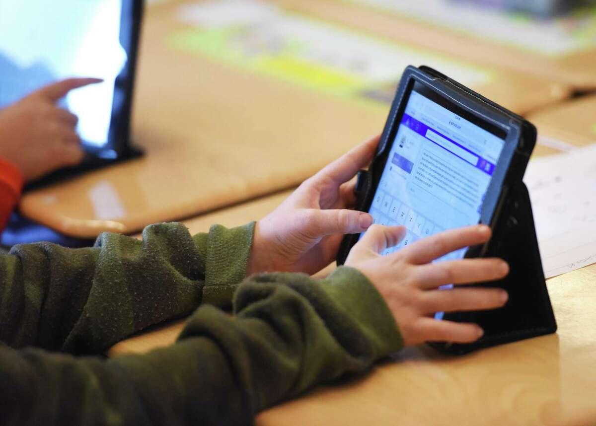 A fifth-grader uses an iPad at Hamilton Avenue School.