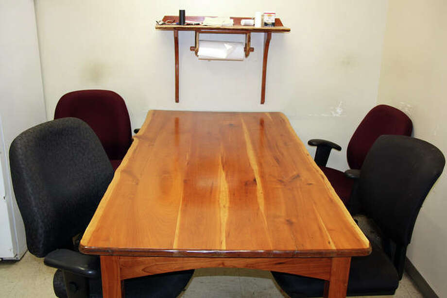 Edwardsville employees crafted his lunchroom table, within the city's street maintenance building, from wood that was on the former Poor Farm site, where the city's public safety building stands today. The rest of the Poor Farm Wood will be auctioned Saturday at the maintenance building.