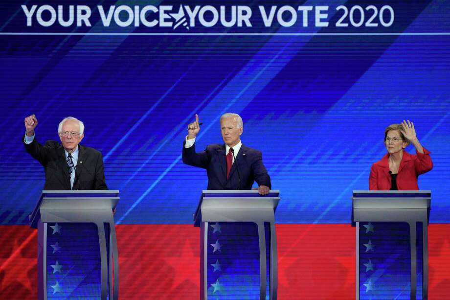 From left, Democratic presidential candidates Sen. Bernie Sanders, I-Vt., former Vice President Joe Biden and Sen. Elizabeth Warren, D-Mass. raise their hands to answer a question Thursday, Sept. 12, 2019, during a Democratic presidential primary debate hosted by ABC at Texas Southern University in Houston. (AP Photo/David J. Phillip) Photo: David J. Phillip / AP