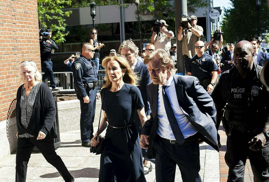 Actress Felicity Huffman, escorted by her husband William H. Macy, makes her way to the entrance of the John Joseph Moakley United States Courthouse September 13, 2019 in Boston, where she will be sentenced for her role in the College Admissions scandal. - Huffman, one of the defendants charged in the college admissions cheating scandal, is scheduled to be sentenced for paying $15,000 to inflate her daughters SAT scores, a crime she said she committed trying to be a good parent. (Photo by Joseph Prezioso / AFP)JOSEPH PREZIOSO/AFP/Getty Images Photo: Joseph Prezioso, AFP/Getty Images