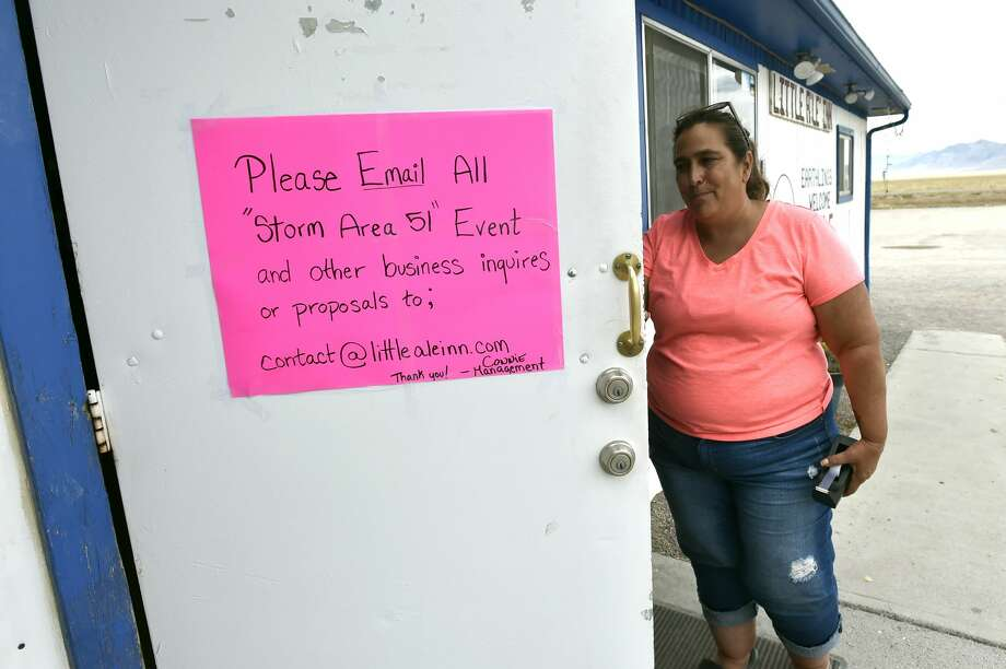 "Proprietor Connie West posts a sign on her front door at the Little A'le'Inn restaurant and gift shop on July 22, 2019 in Rachel, Nevada. West said her phone has been ringing off the hook since a Facebook event entitled, ""Storm Area 51, They Can't Stop All of Us,"" which the author stated was meant as a joke, calls for people to storm the highly classified U.S. Air Force facility near Rachel on September 20, 2019, to address a conspiracy theory that the U.S. government is conducting tests with space aliens.  (Photo by David Becker/Getty Images) Photo: David Becker/Getty Images"