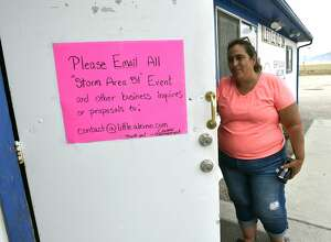 "Proprietor Connie West posts a sign on her front door at the Little A'le'Inn restaurant and gift shop on July 22, 2019 in Rachel, Nevada. West said her phone has been ringing off the hook since a Facebook event entitled, ""Storm Area 51, They Can't Stop All of Us,"" which the author stated was meant as a joke, calls for people to storm the highly classified U.S. Air Force facility near Rachel on September 20, 2019, to address a conspiracy theory that the U.S. government is conducting tests with space aliens.  (Photo by David Becker/Getty Images)"