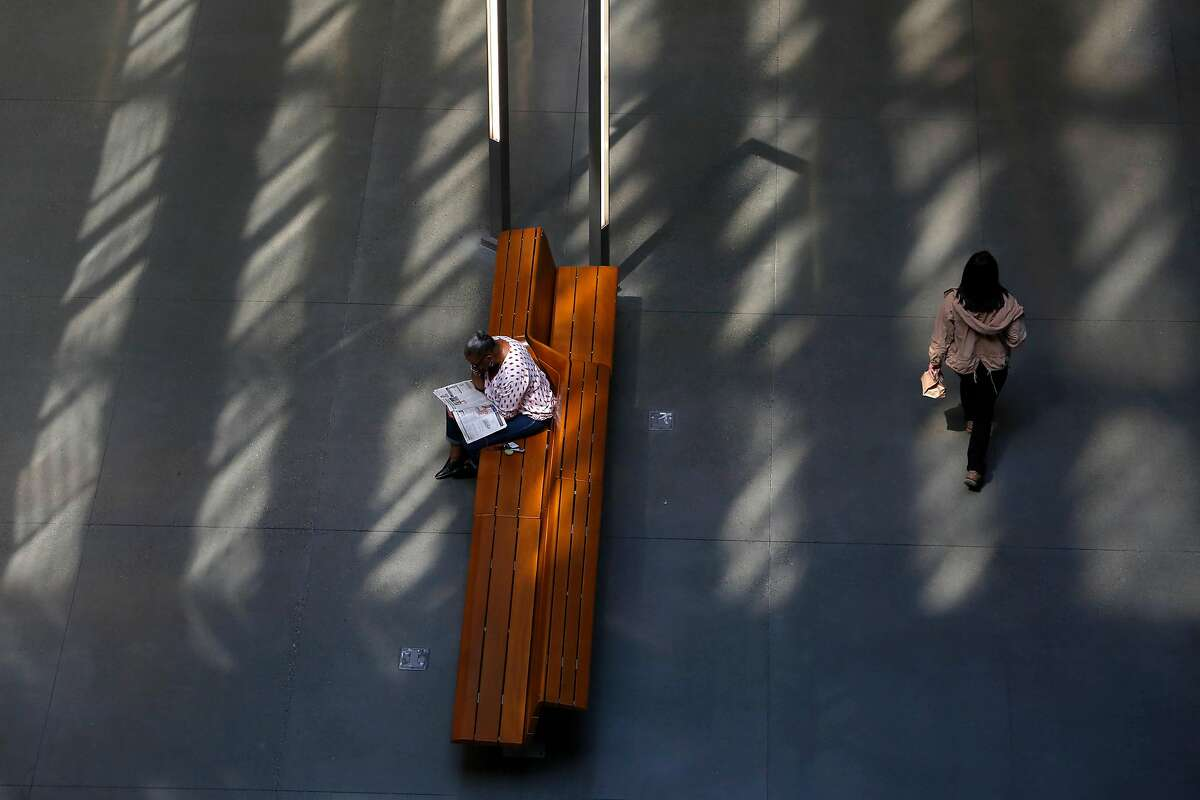 A woman reads on a bench in the lobby of 375 Beale Street on Thursday, September 12, 2019 in San Francisco, CA.