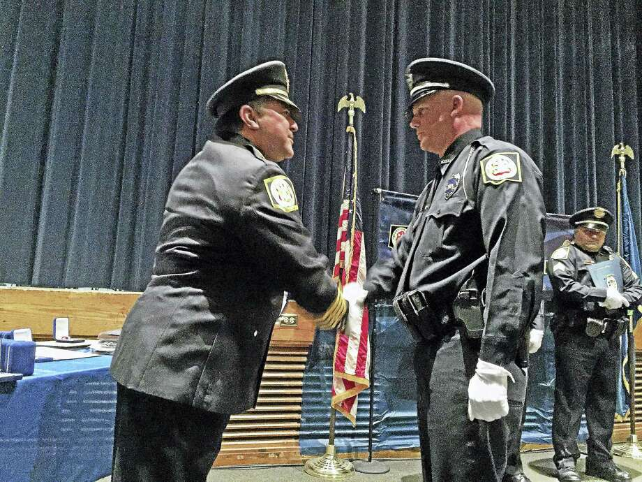 Winchester Police Chief William Fitzgerald Jr. presents a Meritorious Service Award to Acting Sgt. Chris Skinner during the department's award ceremony in 2017. This year's ceremony will be held at 5 p.m. on Sept. 19 at Town Hall. Photo: File Photo / Hearst Connecticut Media