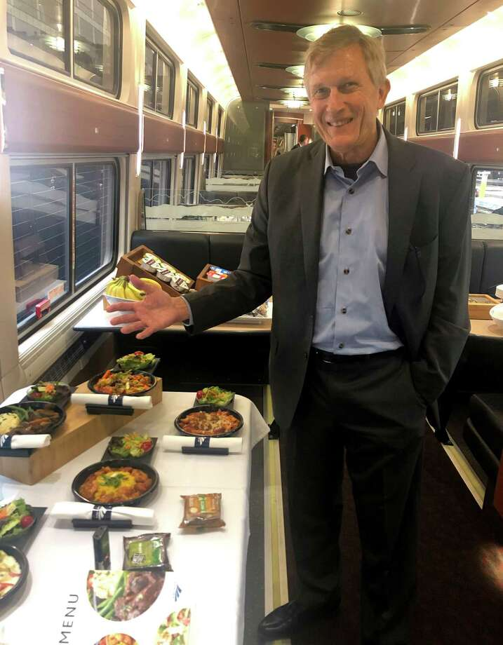 Amtrak VP Peter Wilander displays new hot-food options soon to be available on Amtrak overnight trains. He insists food has not been dumbed down, although Amtrak is saving money on labor costs and improved inventory control. (Dan Freedman/Times Union)