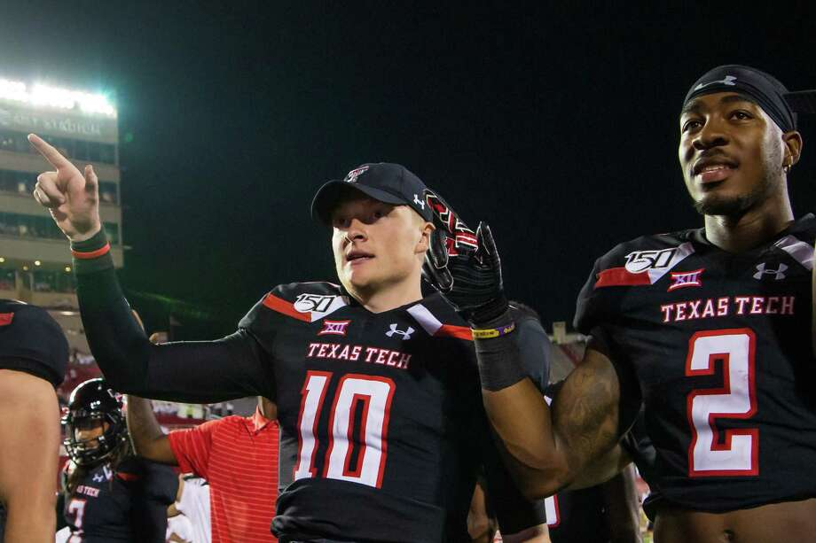 "LUBBOCK, TEXAS - SEPTEMBER 07: Quarterback Alan Bowman #10 and wide receiver RJ Turner #2 signal during ""The Matador Song"" after the college football game between the Texas Tech Red Raiders and the UTEP Miners at Jones AT&T Stadium on September 07, 2019 in Lubbock, Texas. Photo: John E. Moore III, Getty Images / 2019 John E. Moore III"