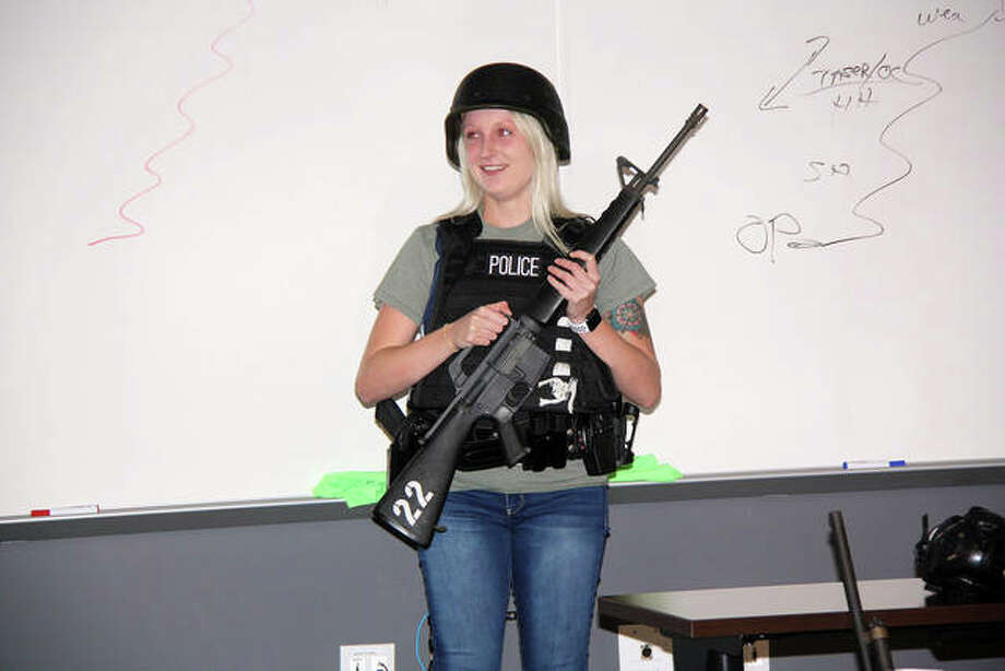 Hannah, a recent SIUE graduate in criminal justice and an area resident, volunteered to try on some of the typical police gear, including a bulletproof vest and duty belt, Thursday during the EPD Citizens' Police Academy.