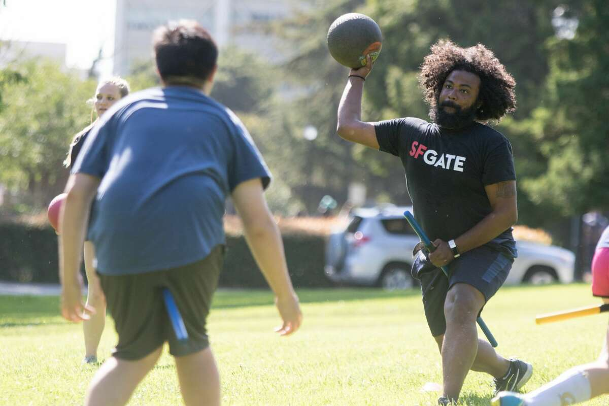 Drew Costley throws a blunger (dodgeball) while taking part in a practice for the Cal Quidditch team on Sept. 10, 2019.