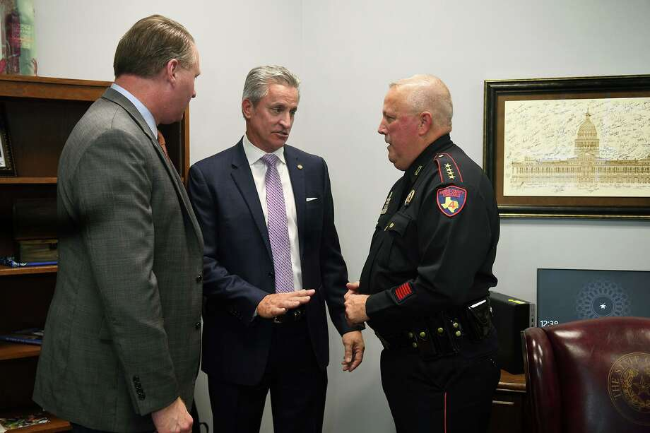 Sam Harless, center, State Representative of District 126, visits with Precinct 4 Justice of the Peace Position 1 Judge Lincoln Goodwin, left, and Pct. 4 Constable Mark Herman, during a ribbon cutting ceremony held at Harless's new office located at 6630 Cypresswood Dr. in Spring on Sept. 13, 2019. Photo: Jerry Baker, Houston Chronicle / Contributor / Houston Chronicle