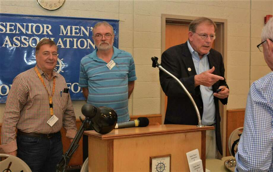 Al Aliperdi, Stamford Senior Men's Club member, John Cullen, Senior Men's Club president listen as Clif McFeely of New Canaan, founder of Future 5, describes the organization's work with Stamford students. Photo: Contributed Photo / Future 5 / New Canaan Advertiser Contributed