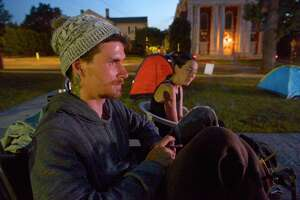 """Edward """"Eddie"""" Goralnik Jr and Candra Dacosta, both of Danbury, and other's that are homeless prepare to spend another night sleeping in tents in front of city hall as a to protest the closing of the Jericho shelter. Tuesday night, September 10, 2019, in Danbury, Conn."""