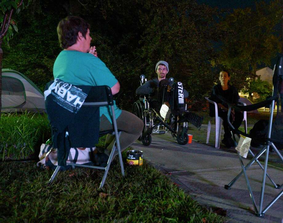 "Cynthia Dacosta, left, Edward ""Eddie"" Goralnik Jr and Candra Dacosta and other's that are homeless prepare to spend another night sleeping in tents in front of city hall as a to protest the closing of the Jericho shelter. Tuesday night, September 10, 2019, in Danbury, Conn. Photo: H John Voorhees III / Hearst Connecticut Media / The News-Times"